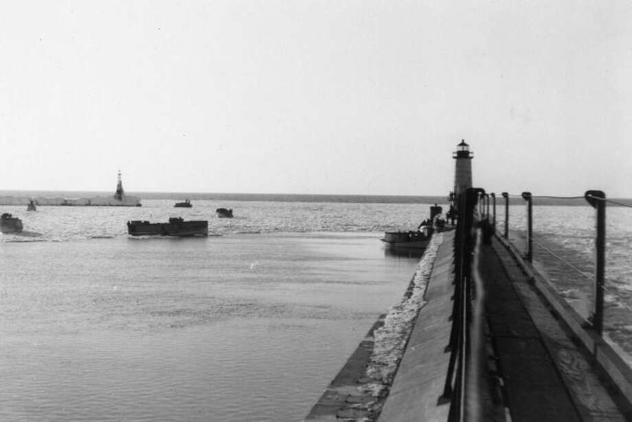 This 1940s photograph shows the view down the catwalk at Fifth Avenue Beach lighthouse leading out to the lighthouse.