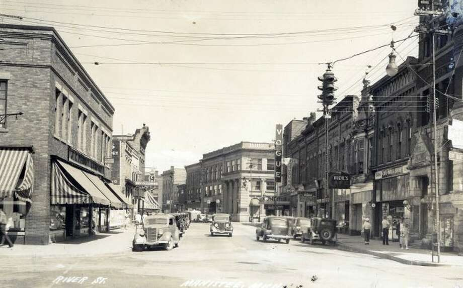 River Street in the late 1930s was a full of activity when this photograph was taken on a summer day. The buildings looked much the same, but with many different stores located in them.
