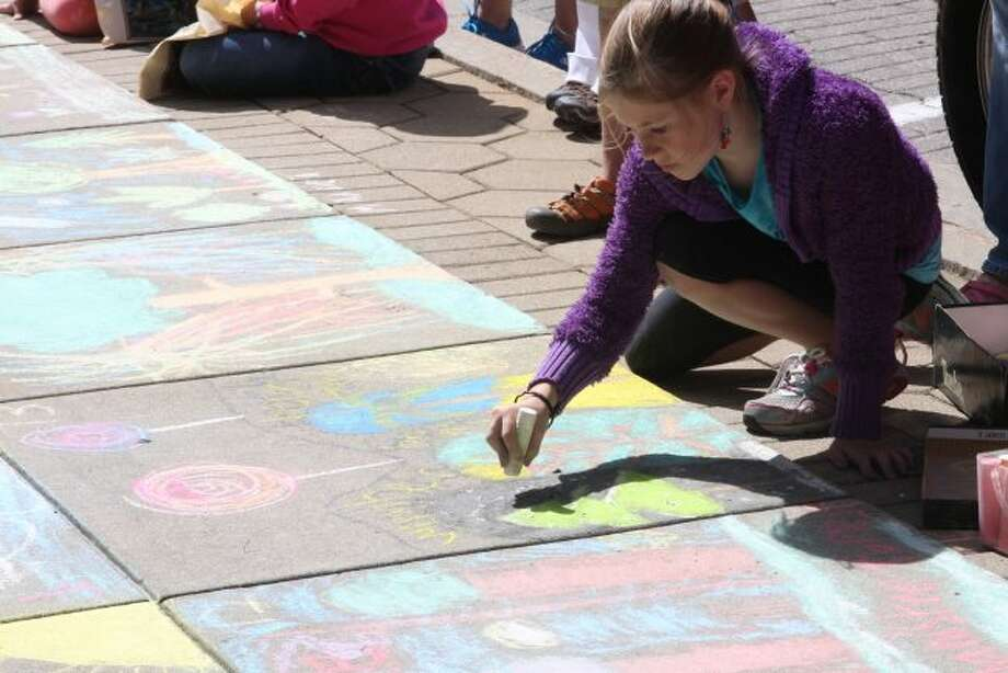 One of the events the City of Manistee Tree Commission sponsors every year is the Forest Festival Chalk Art contest where the children are asked to draw pictures about trees.