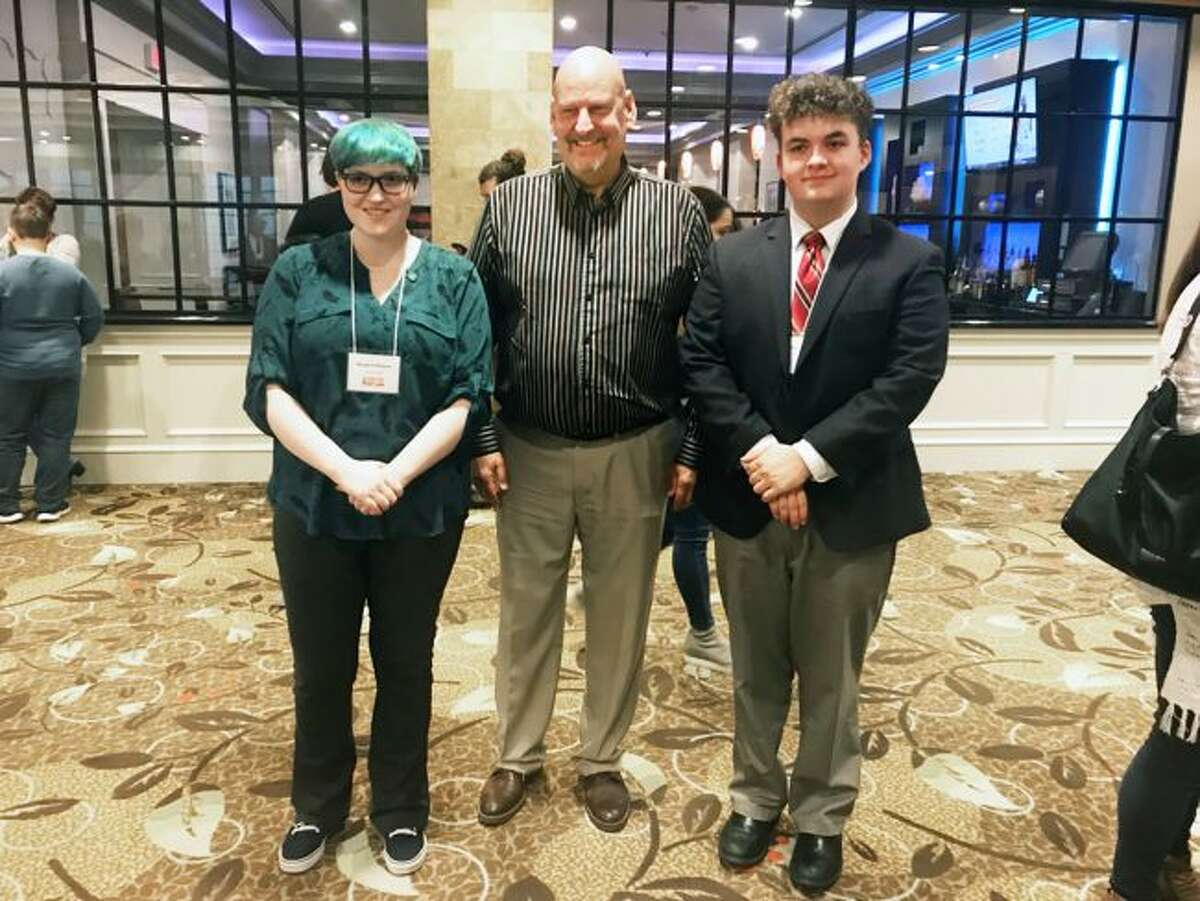 Sen. Curt VanderWall, R-Ludington; Margaret Roberts, a senior at The Leelanau School in Glen Arbor; and Reese Papenfuss, a senior at Manistee Catholic Central School in Manistee attended the Michigan state finals of Poetry Out Loud (POL), a national poetry recitation competition for high school students. Roberts and Papenfuss were two of three state finalists from the 35th Senate District at the Lansing event.