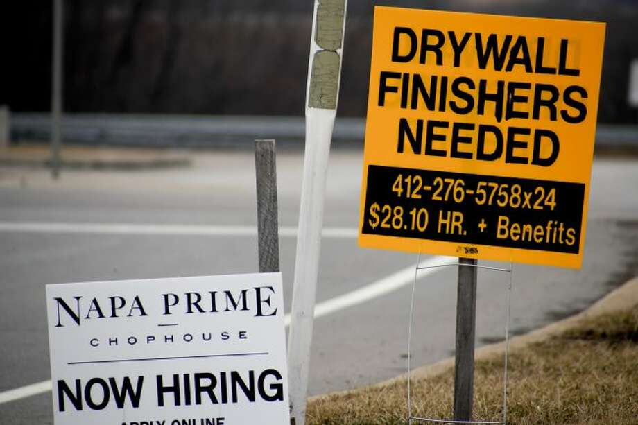 In this March 1, 2019, photo signs for employment opportunities are posted at an exit ramp off of Interstate 79 in Zelienople, Pa. On Tuesday, May 7, the Labor Department reports on job openings and labor turnover for March. (AP Photo/Keith Srakocic)