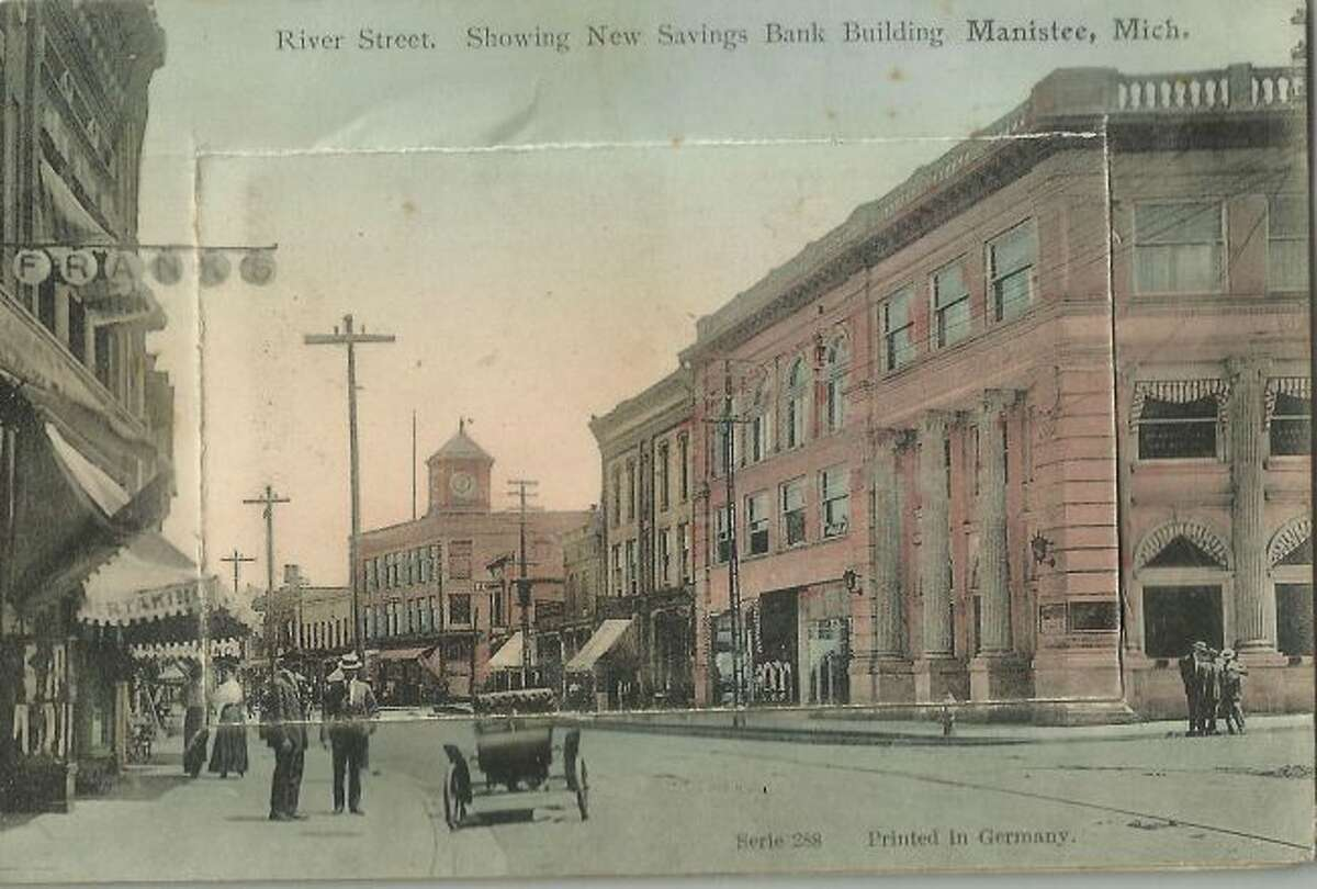 This very early 1900 photograph of River Street looking east shows the Manistee County Savings Bank building in the background.
