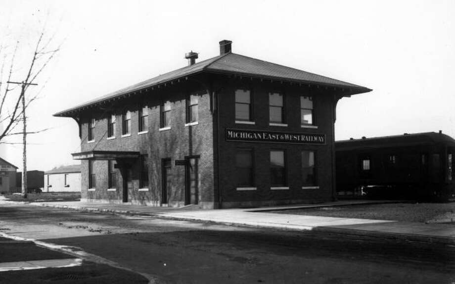 The Michigan East & West Railway Depot is shown in the picture from the early 1900s and was located on River Street. The building most recently was used as the Johnson Funeral Home.
