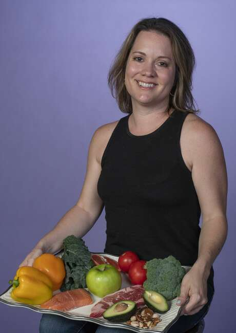 Erica Mann, owner of the Blue Door and a health coach, normal diet consists of vegetables and proteins Photo: Tim Fischer/Midland Reporter-Telegram