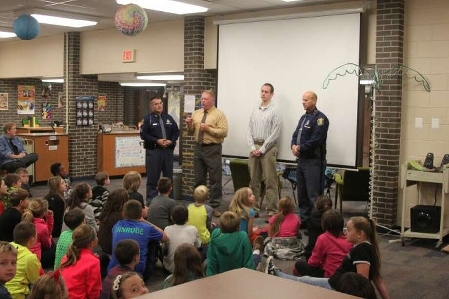 The Michigan State Police Internet Crimes Against Children Task Force consisting of Detective/Sgt. Wesley Smith, D/Trooper Greg Hubers, D/Trooper Gordon Armstrong and school liaison officer Dave Pritchard met with students at Kennedy and Jefferson elementary schools on Monday to talk about cyber safety.