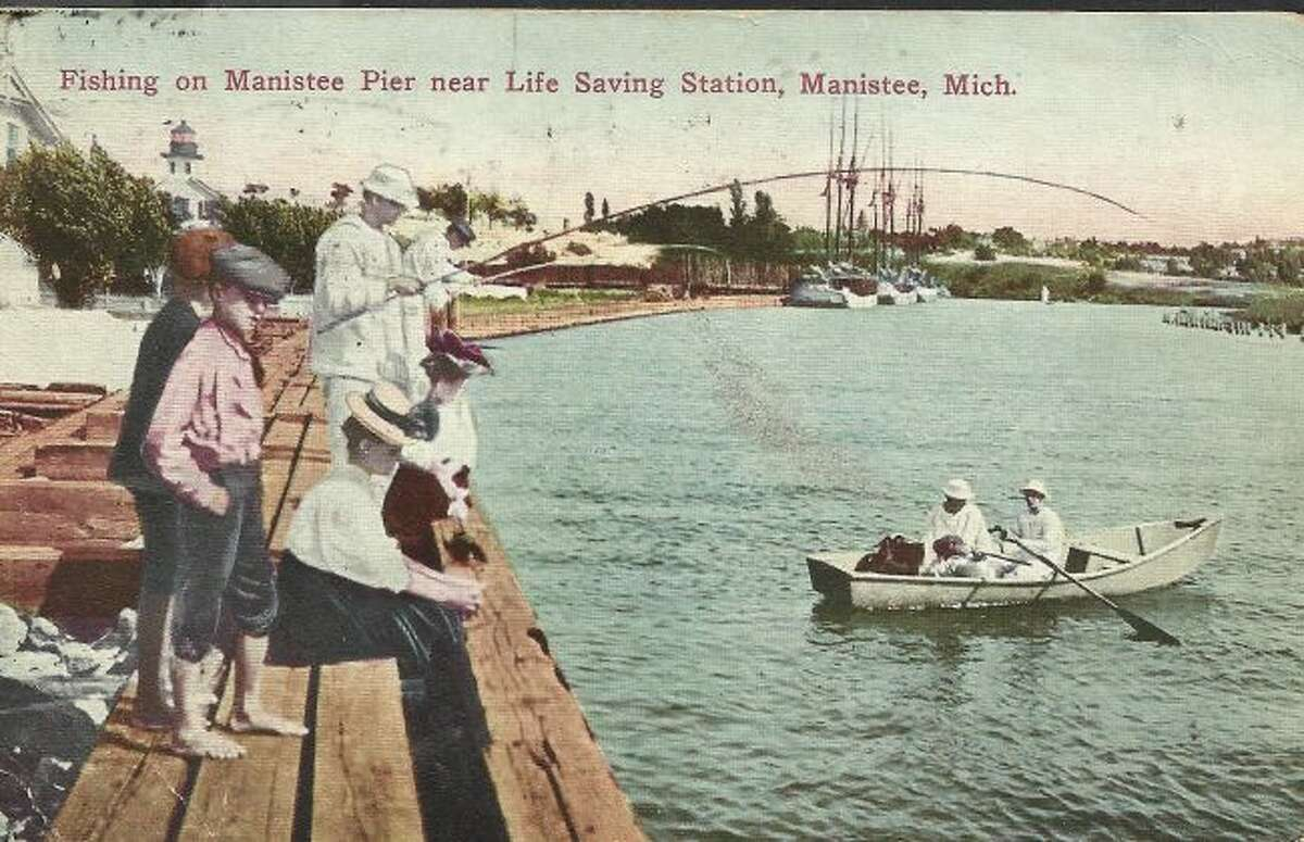 Fishing off the pier by the Life Saving Station is shown in this 1890s photograph.
