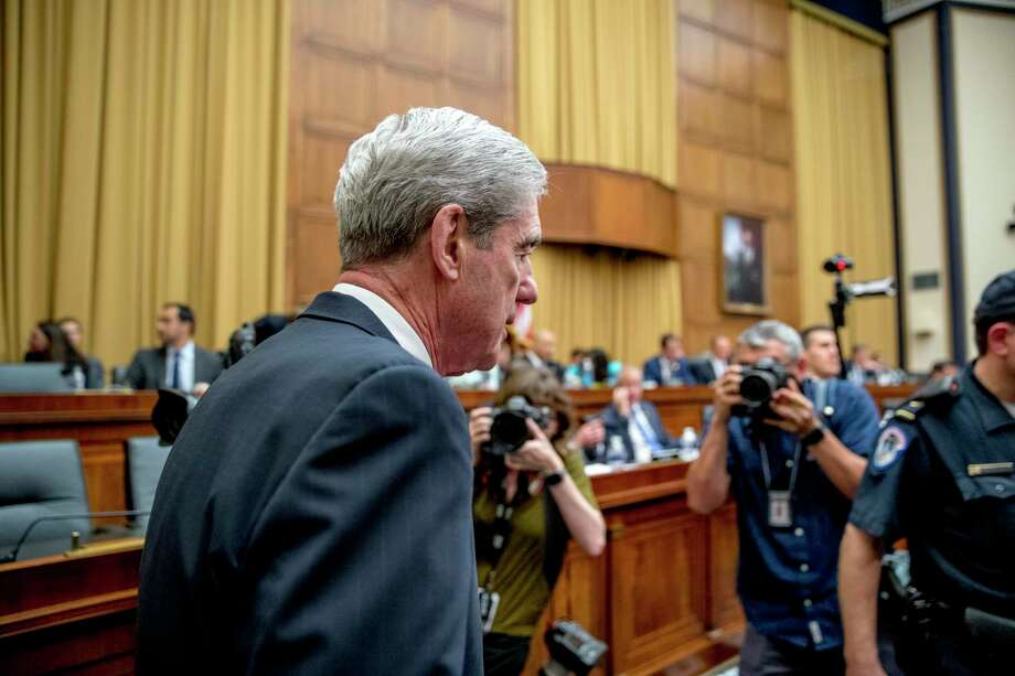 Former special counsel Robert Mueller returns from a short break while testifying before the House Intelligence Committee hearing on his report on Russian election interference, on Capitol Hill, in Washington, Wednesday. Photo: Andrew Harnik / Associated Press / Copyright 2019 The Associated Press. All rights reserved