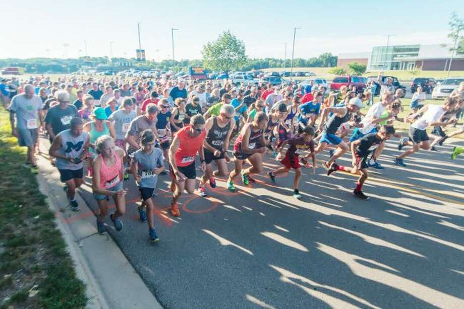David Navadeh/News AdvocateOver 300 runners completed the Firecracker 5K run at Manistee High School Saturday morning.