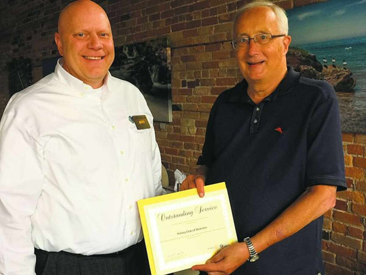 The Manistee Rotary Club was presented with a certificate for Outstanding Service by Rotary District No. 6290 in 2018. Pictured are Jon Catlin, District Treasurer, and Bill Zamrowski, Interim Club President.