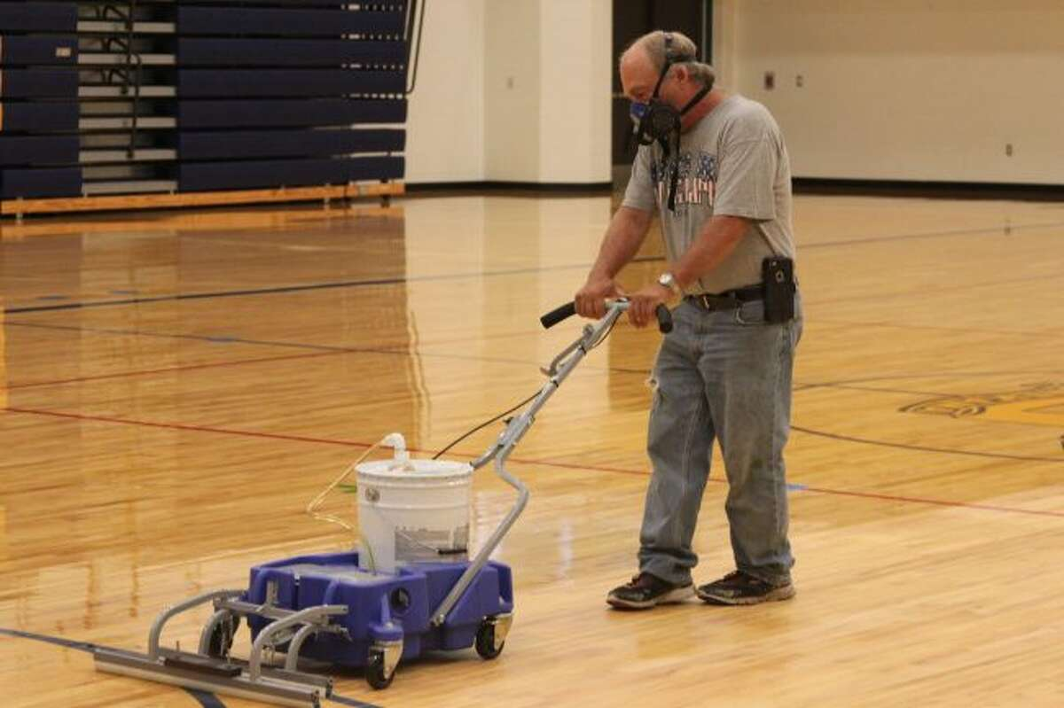 One of the manner projects taking place at Manistee County schools over the summer to prepare for the next school year is the refinishing of the gymnasium at Onekama Schools.