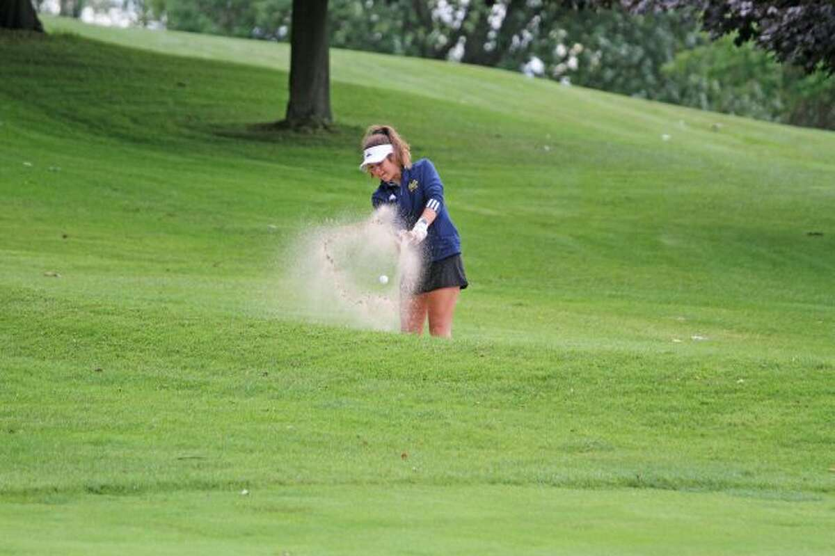 Manistee's Sara Thompson blasts a shot out of the bunker on the 9th hole at the Manistee Golf and Country Club during the Chippewas' quad meet against Leland, Whitehall and Cadillac Wednesday. (Kyle Kotecki/News Advocate)