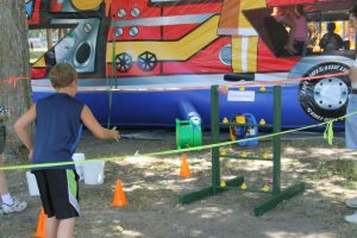 A child plays a game in the village park during the 2015 Copemish Heritage Days. Festivities kick off at 12 p.m. Aug. 6 when the horseshoe tournament starts.