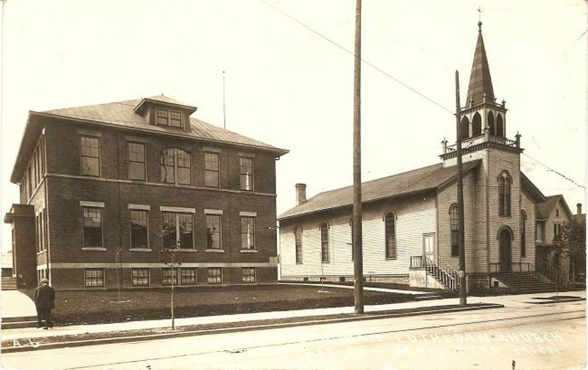 The Trinity Lutheran School and Church that were located on First Street are shown in this photograph from the 1930s.