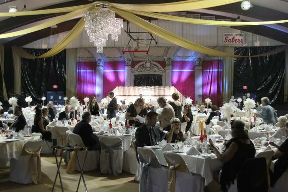 The Manistee Catholic Central gymnasium was transformed into an elegant ballroom for the HARVEST Glitz and Glamour event on Saturday.