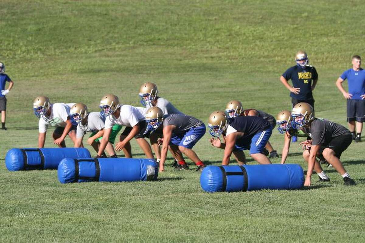 Brian Fogg/News AdvocateOnekama's offense lines up to run a play on the first day of practice on Monday. The Portagers will start the season at home on Thursday, Aug. 25.