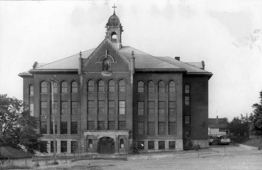 The St Joseph School that was located behind the current St. Joseph Church and later burned down is shown in this 1950s photograph.
