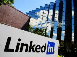 FILE - In this Monday, May 9, 2011 file photo, LinkedIn Corp., the professional networking Web site, displays its logo outside of headquarters in Mountain View, Calif. LinkedIn began 2014 with its largest quarterly loss since going public as the online professional networking service ramped up its investments in projects aimed at attracting more users on the lookout for better jobs and career advice.. (AP Photo/Paul Sakuma, File)