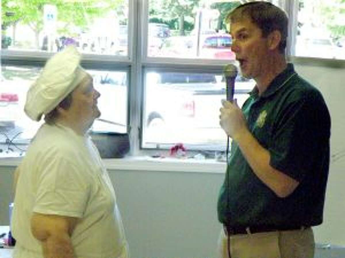 """A large crowd turned out at the Manistee Senior Center this week for Wheelin' and Dealin' with Johnny O, which is similar to """"Let's Make a Deal."""" Manistee County undersheriff John O'Hagan has hosted the event several times."""