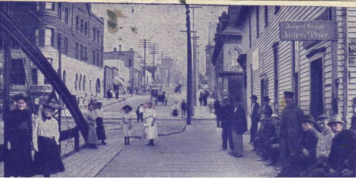 The photo shows the intersection of Maple and River streets in 1890.