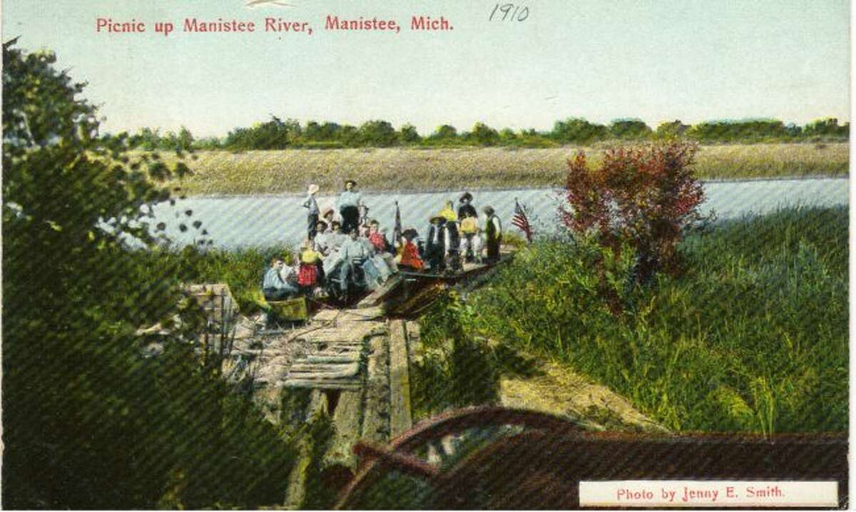 Family picnics were a big thing on a Sunday afternoon in the early 1900s as depicted in this photograph that was taken along the Manistee River.