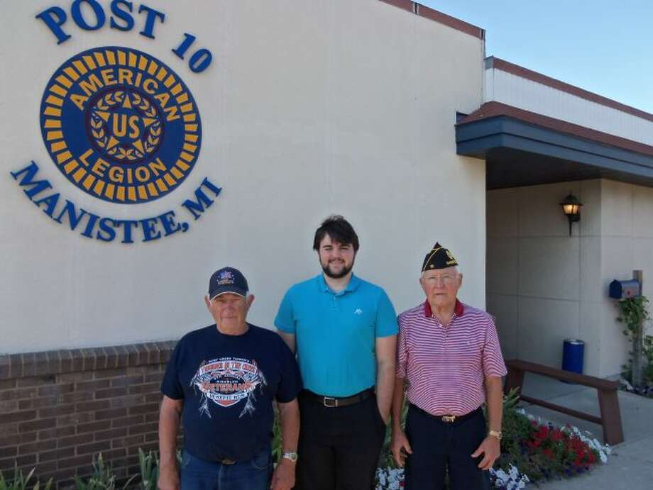 Boys State participant Josh Fleszar poses for a photograph with American Legion No. 10 commander Ralph Reynolds and Manistee's Boys State program director Blair Mohney.