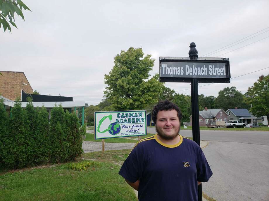 Thomas Deloach, the CASMAN Academy student of the week is shown here in front of the street sign naming the school driveway in his honor. Thomas was selected by the teacher and staff with comments like; He is always respectful when talking to him. Thomas is a studious young man. He takes time to think before he responds; and it's always a pleasure to read his interpretations and thoughts in class. He is a quite leader among our students.