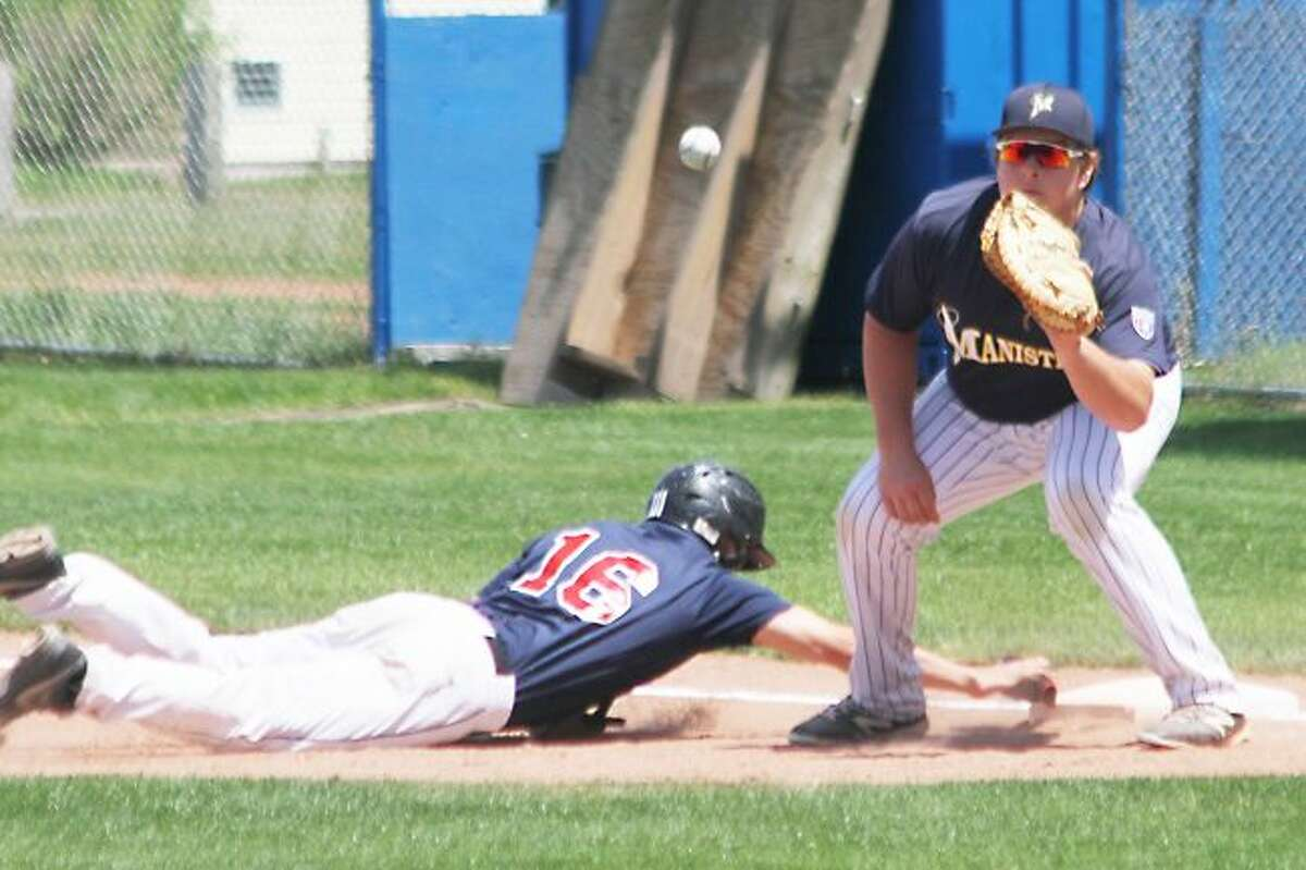 Scott Yoshonis/News AdvocateManistee first baseman Nolan Vander Weele fields the ball on a pickoff attempt in a game earlier this season. Vander Weele was one of a handful of young Saints players with local ties this season.