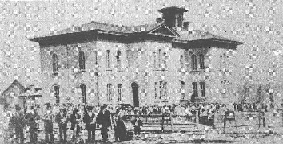 Manistee's first brick school, which stood on the corner of First and Oak streets from 1866 to 1886.