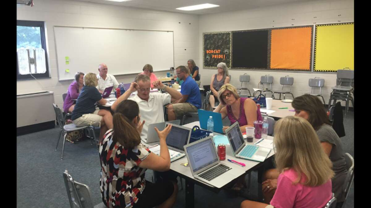 Brethren Elementary School teachers work on new programs for improving literacy under the guidance of district literacy coach Jennifer Cordes and Manistee Intermediate School District consultant Dency Lippert. All schools in the county will soon be entering similar training.