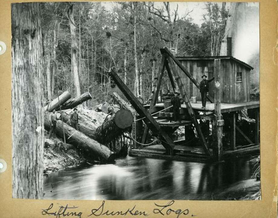 Lumbjacks use this crane type of device to pull logs that sank to the bottom of the Manistee River on their way to be floated to the sawmill.