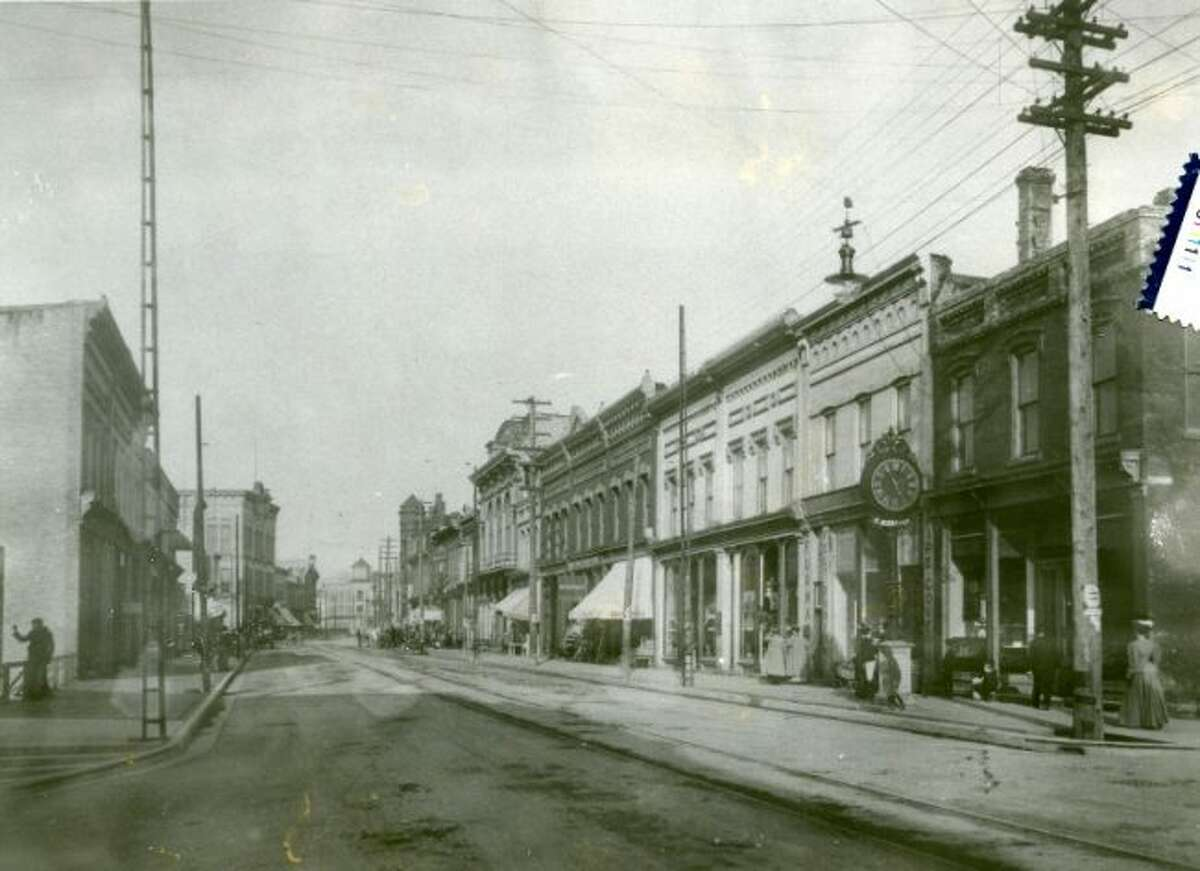 The Manistee County Historical Museum will be holding walking tours of the River Street area at 2 p.m. and 7 p.m. on Aug. 24 and 31 that will be conducted by Manistee County Historical Museum Executive Director Mark Fedder deal with the people who built the buildings and the businesses. Shown is the 1890s view of River Street looking east from Oak Street.