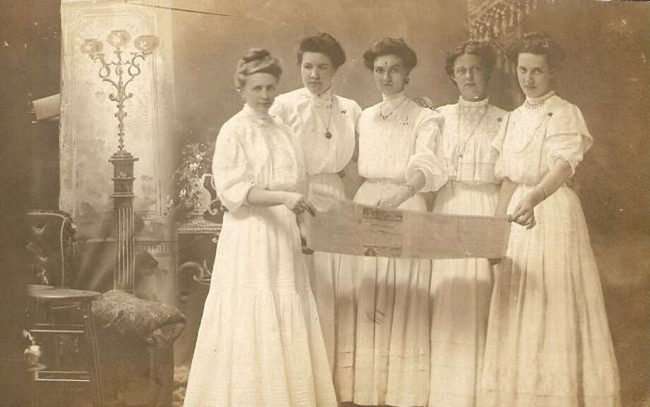 This group of Manistee ladies from the Victorian era are shown looking at a newspaper in the late 1800s.