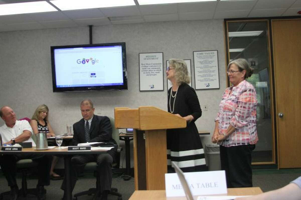 WSCC Dean of Arts and Sciences Dr. Brooke Portmann and Distance Learning Consultant Patti Davidson address the college board of trustees on the online class program at the college.