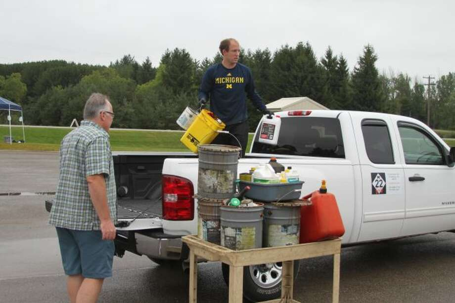 Workers from Drug and Laboratory out of Grand Rapids carefully sort through the household hazardous waste items that came in so they can be properly disposed of. The annual collection drew in many people to the Manistee County Road Commission.