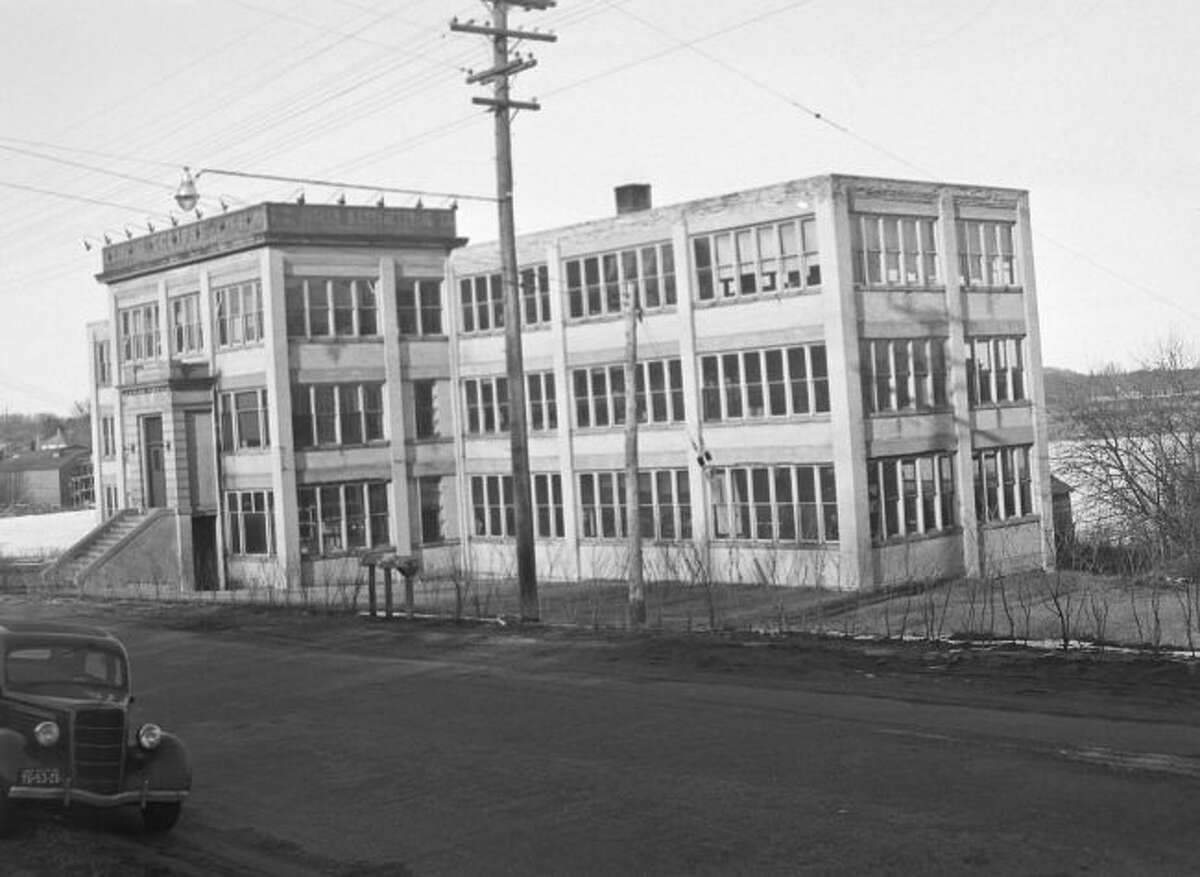 The Joslin Watch Factory that was located on the shores of Manistee Lake is shown in this 1930s photograph. The location is presently the home of the Joslin Cove Condominiums.