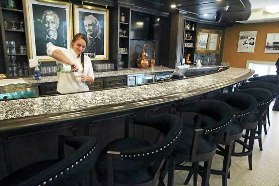 The Maverick Whiskey Distillery in downtown San Antonio has been open just a few days. Here, bar supervisor Sydney Stief works behind the counter.
