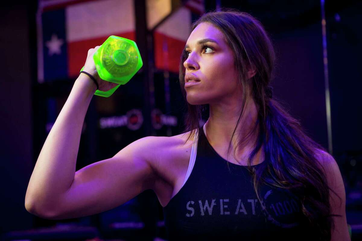 Charlise Springer poses for a portrait at SWEAT 1000 in the Heights on Tuesday, July 23, 2019, in Houston. Springer, wife of Houston Astros outfielder George Springer, has recently started teaching classes at the facility.