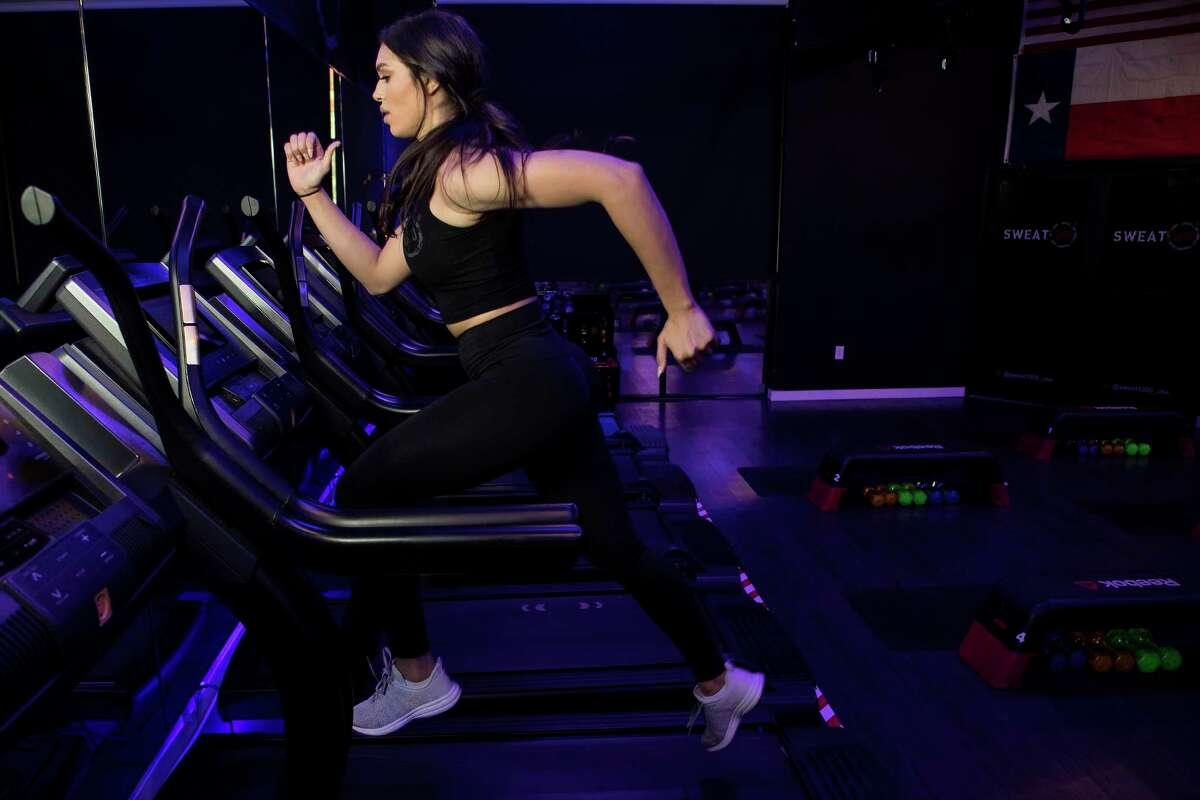 Charlise Springer runs on a treadmill at SWEAT 1000 in the Heights on Tuesday, July 23, 2019, in Houston. Springer, wife of Houston Astros outfielder George Springer, has recently started teaching classes at the facility.