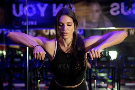 Charlise Springer demonstrates some training techniques at SWEAT 1000 in the Heights on Tuesday, July 23, 2019, in Houston. Springer, wife of Houston Astros outfielder George Springer, has recently started teaching classes at the facility.