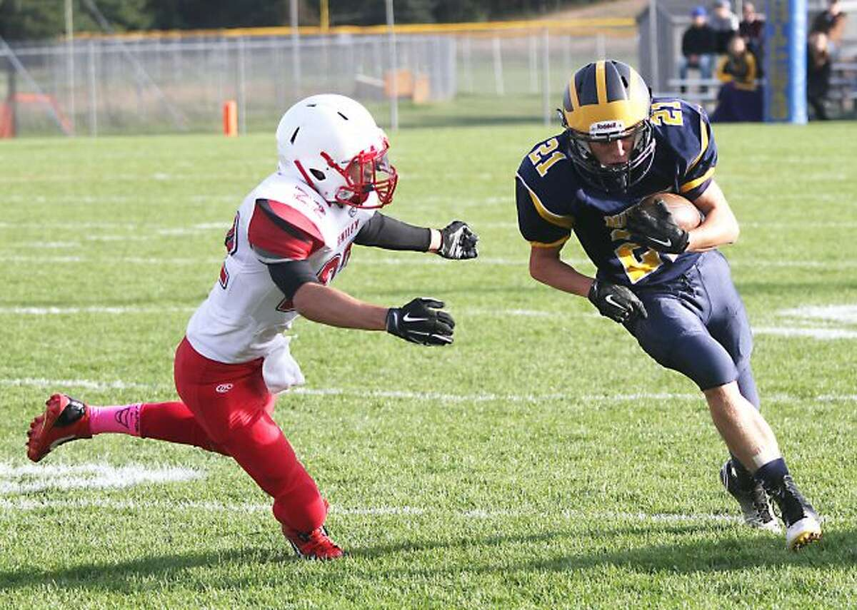 Manistee senior running back Chase Swidorski breaks a run last season against Burton Bentley. He looks to be a big part of the backfield again this year.