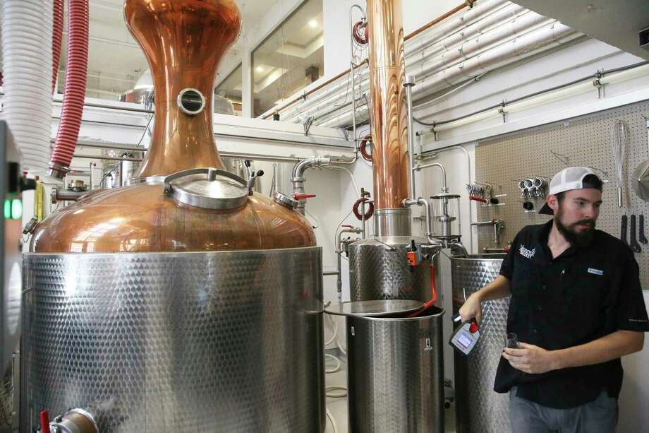 Tyler Goggans checks distilling operations at Maverick Distillery. Photo: Tom Reel /Staff Photographer / 2019 SAN ANTONIO EXPRESS-NEWS
