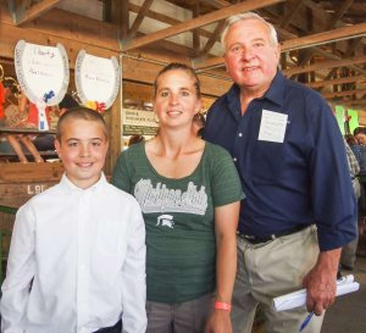 Franz was the winning bidder for the youngster's three rabbits, just as he was the winning bidder 25 years ago for Christina's rabbits when she was in 4-H.