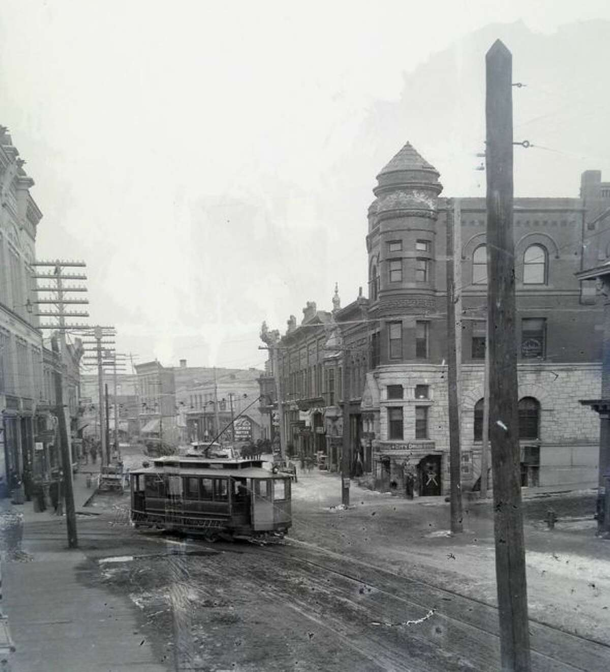 A streetcar rounds the corner of Maple Street onto River Street in the mid-1890s prior to the implementation of cement sidewalks.