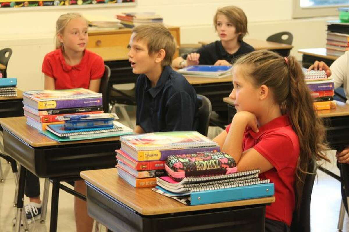 Students from Nick Fedder's class at Manistee Catholic Central hear details from him about what to expect in the upcoming months in his classroom.