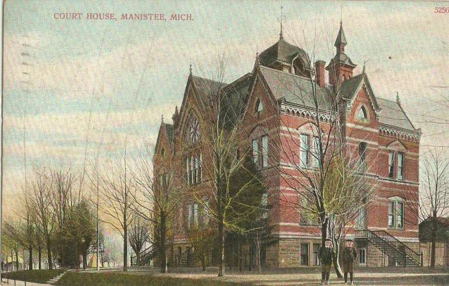 The old Manistee County Courthouse is shown in this photograph from the early 1900s.