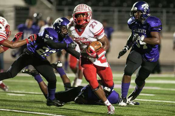 Crosby's Austin Walter (27) rushed for 267 yards on 13 carries in the first half against Humble at Turner Stadium on Oct. 31, 2013. (Photo by AMANDA J. CAIN/ The Observer)
