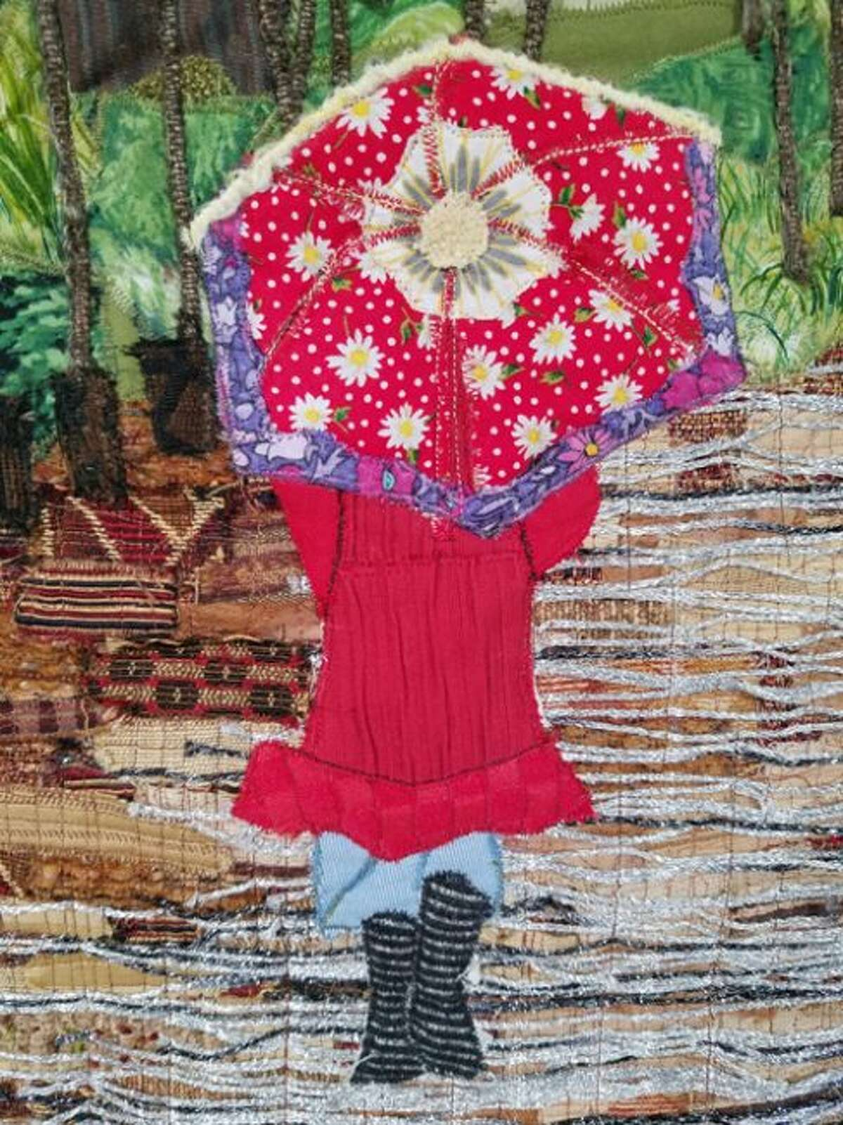 """Shown is Carol Marshall's quilt called """"Walking in the Rain that will be on display with many of her works on display at the Ludington Center for the Arts Nov. 1-15."""
