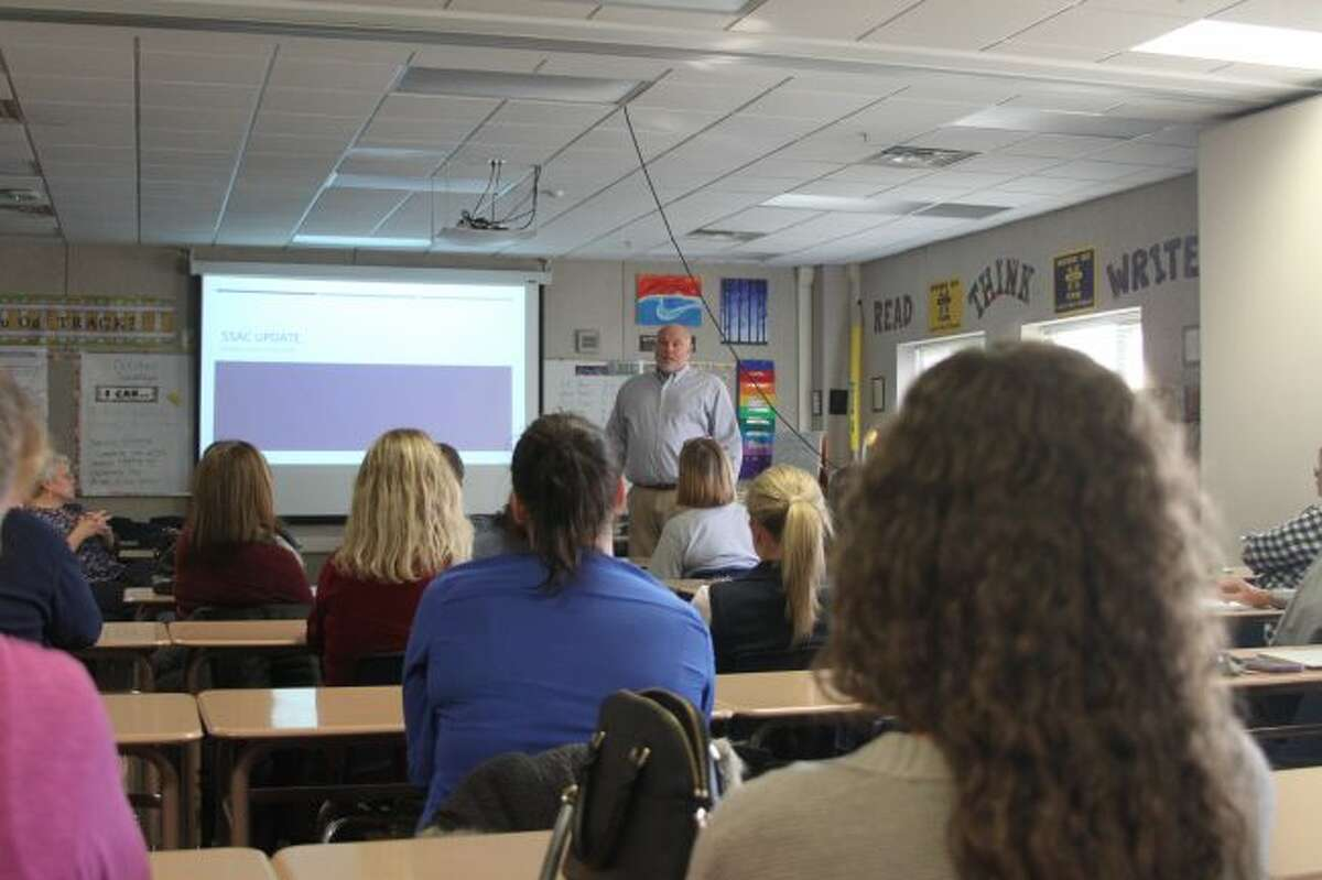 Manistee Area Public Schools superintendent Ron Stoneman addresses a group of staff members this week about procedures and programs they have in place at the district for better communication and for dealing with problems.