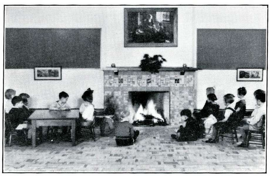 The roaring fire in the fireplace at the Washington Elementary School helped keep the students warm in this 1930s photograph.