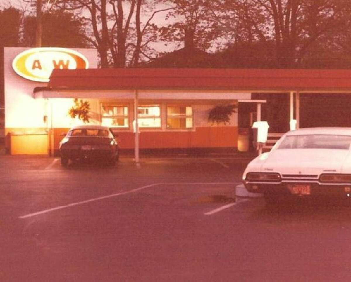 The A &W Drive Inn used to located in Parkdale in the current west end of Watson's Chrysler car lot. This 1970's photo shows how people used to pull up and order their food and then it was brought out to vehicle.